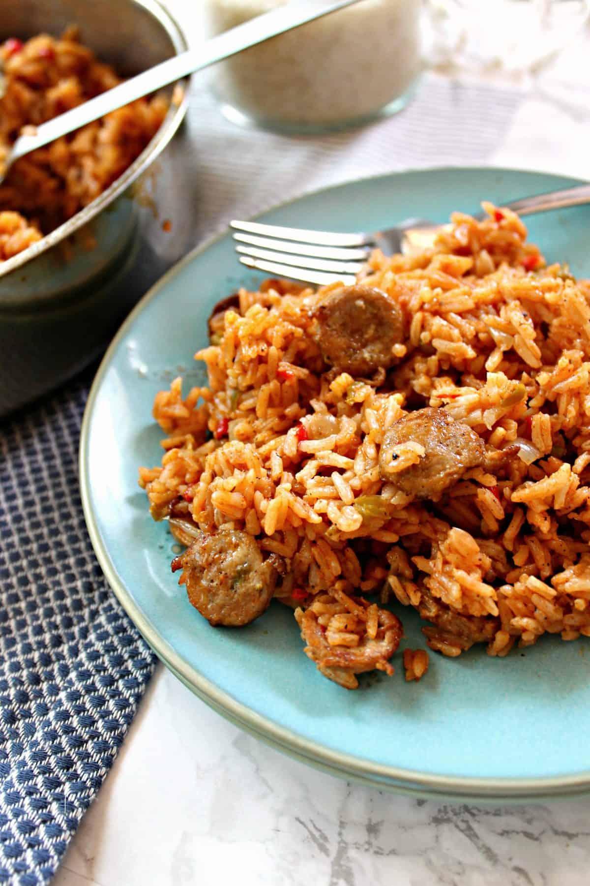 Closeup of arroz con salchicha on plate.