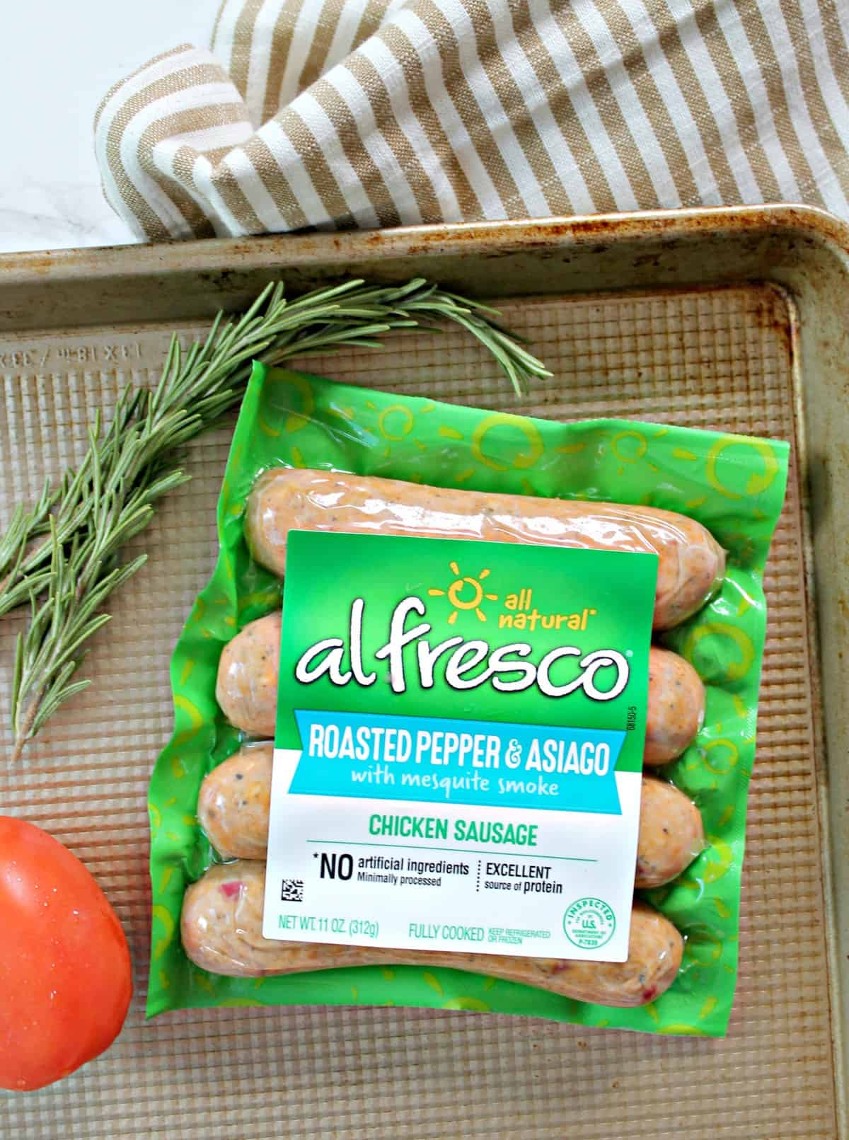Package of al fresco chicken sausage on pan.