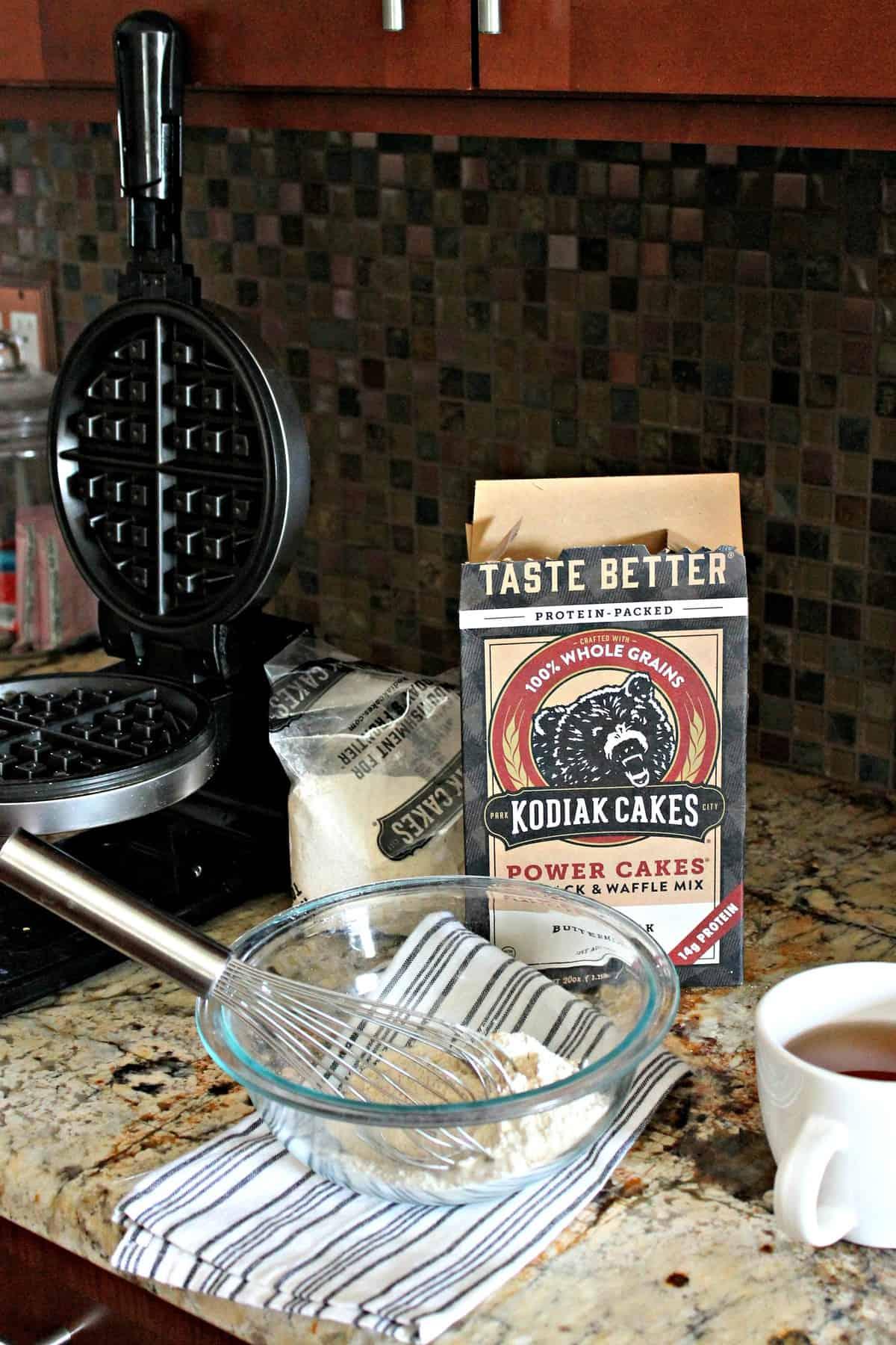 Ingredients set up to make Kodiak Cakes Waffles.