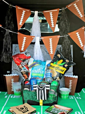 Car tailgate decorated with football decor for Super Bowl.