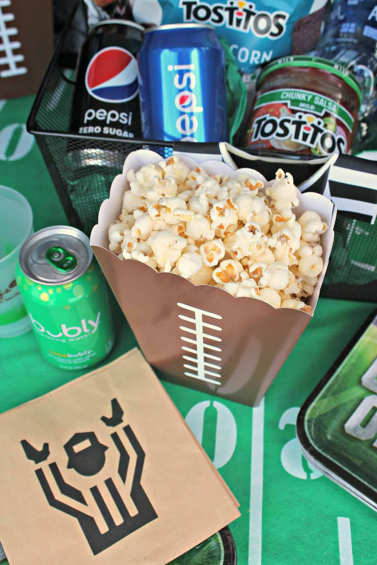Close up of popcorn in football themed container.