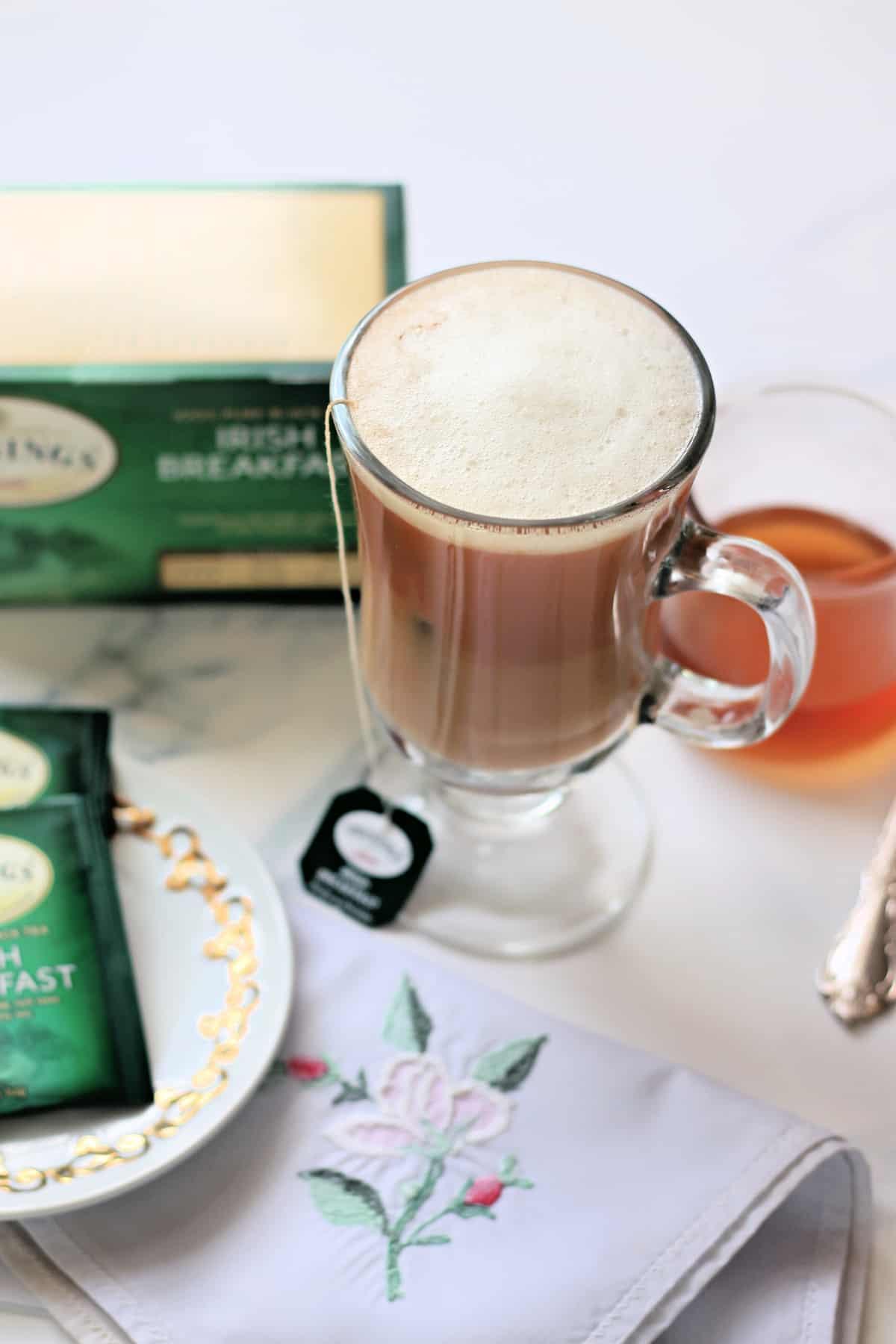 Dublin Fog tea latte in a glass mug.