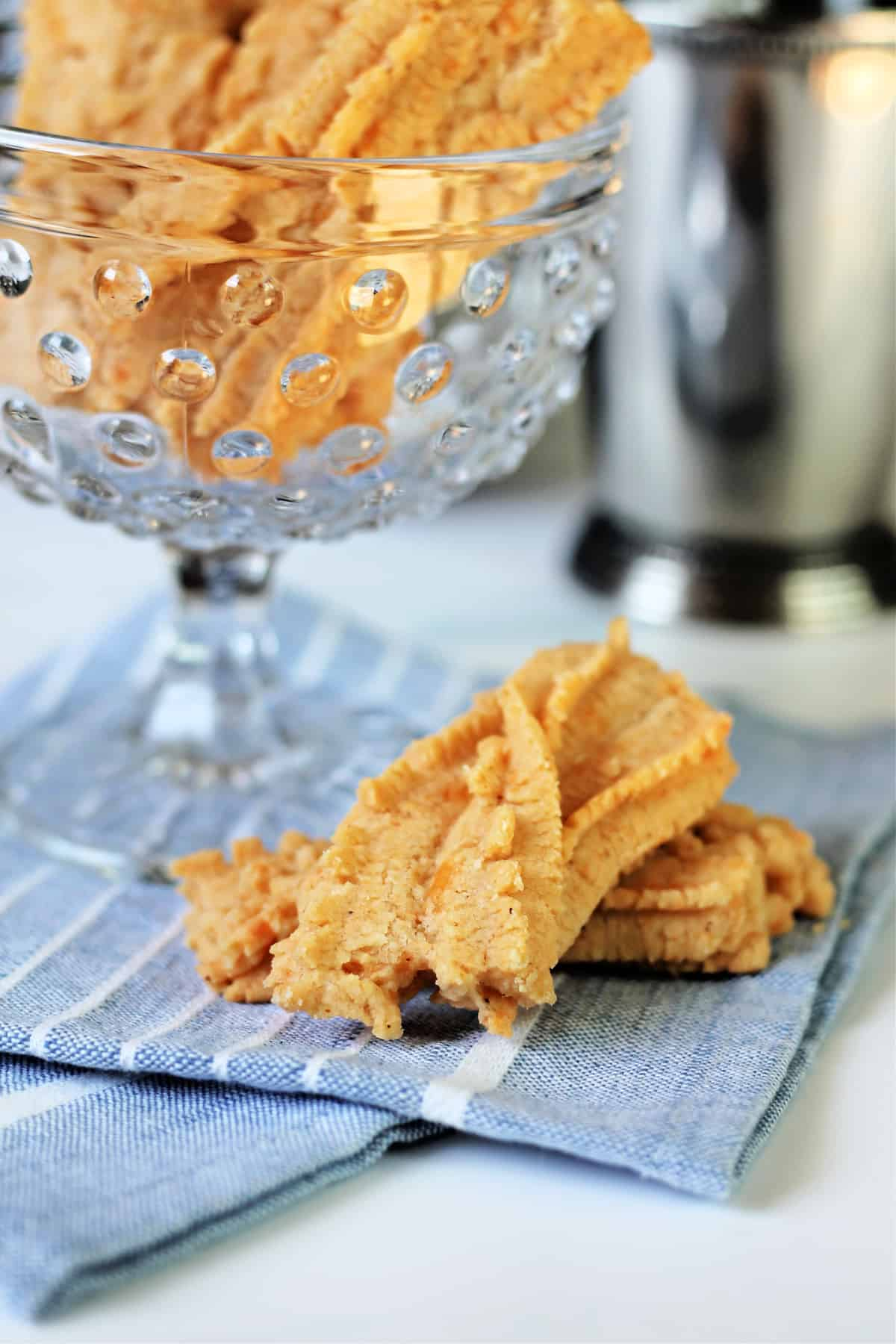 Southern Cheese Straws on a blue linen napkin.