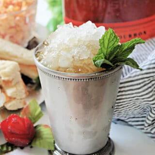 Mint Julep in a silver julep cup with a sprig of mint.