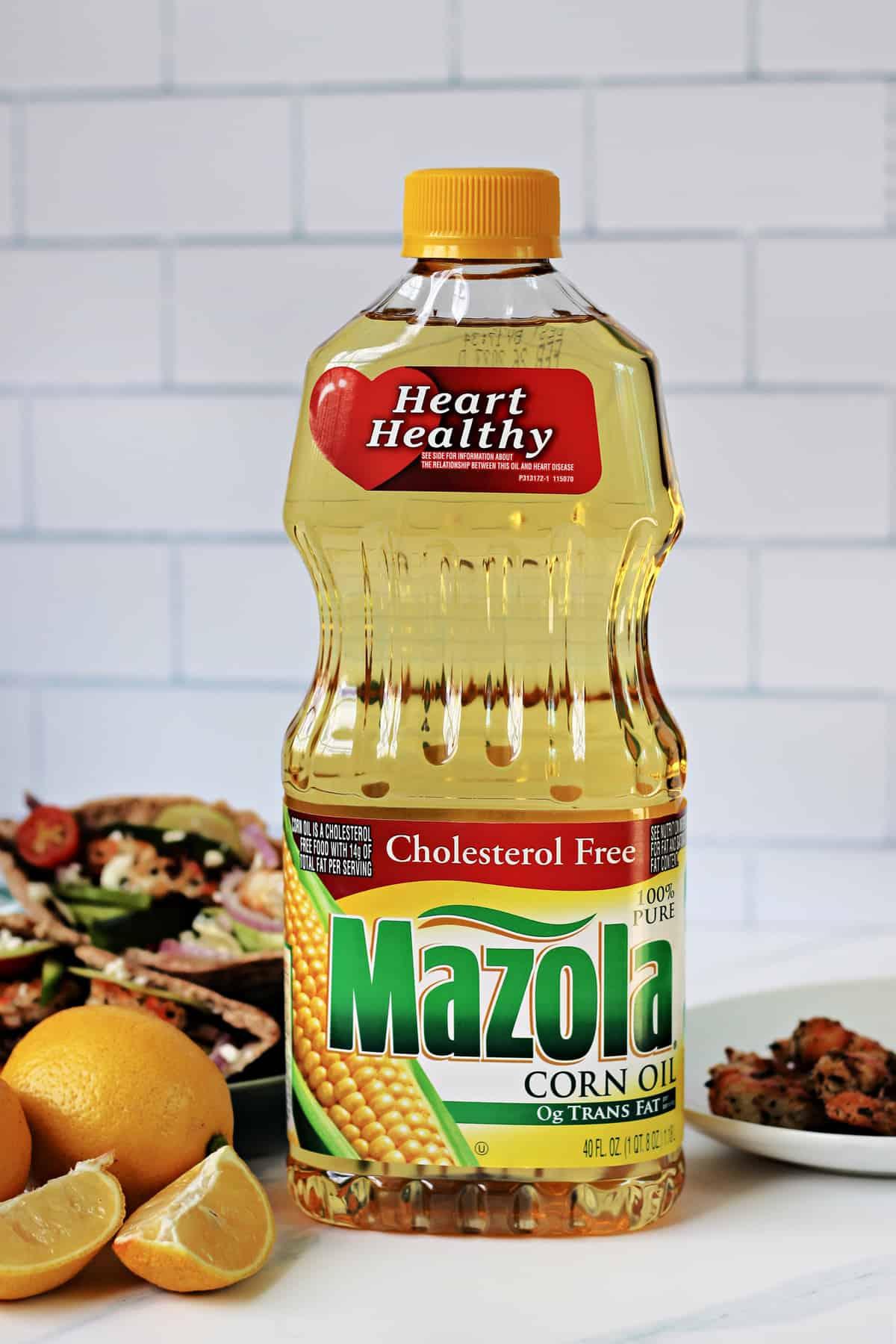 Mazola Corn Oil next to Grilled Greek Shrimp Pitas.