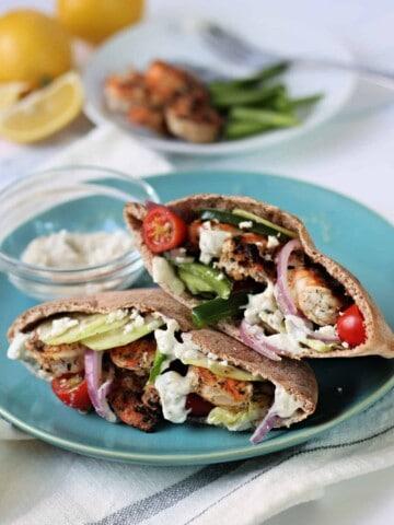 Grilled Greek Shrimp Pita on a teal plate.
