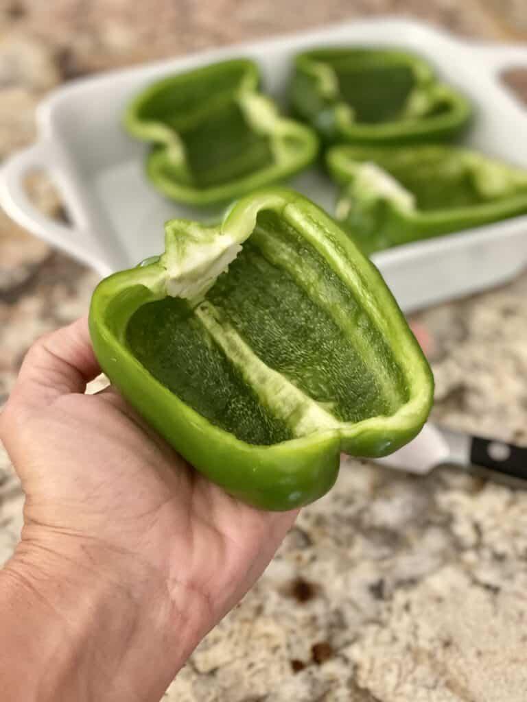 Green bell pepper sliced in half for stuffed peppers.