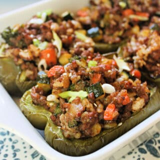 Asian-Inspired Stuffed Peppers in a white baking dish.