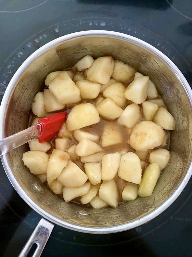 Pears tossed with brown sugar, lemon and nutmeg in a saucepan for Caramel Pear Butter.